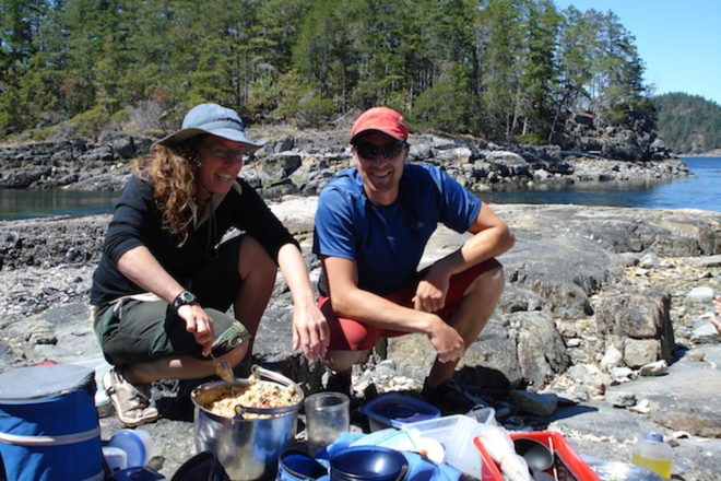 Two guides serve lunch on a Desolation Sound kayak tour