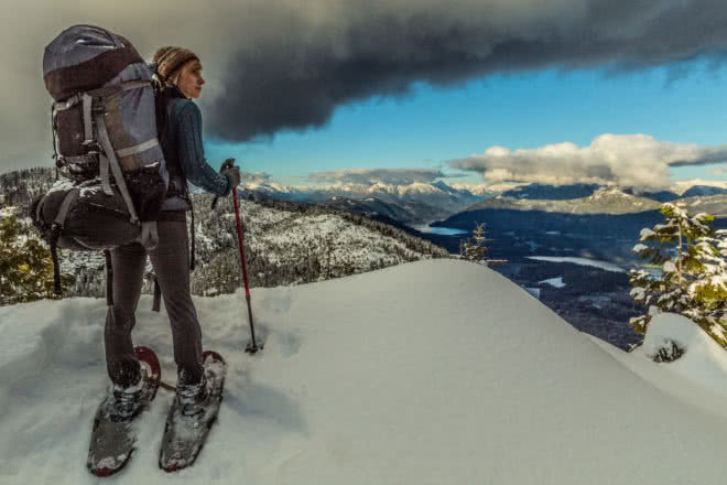 A Snowshoer looks out over the Powell River Backcountry