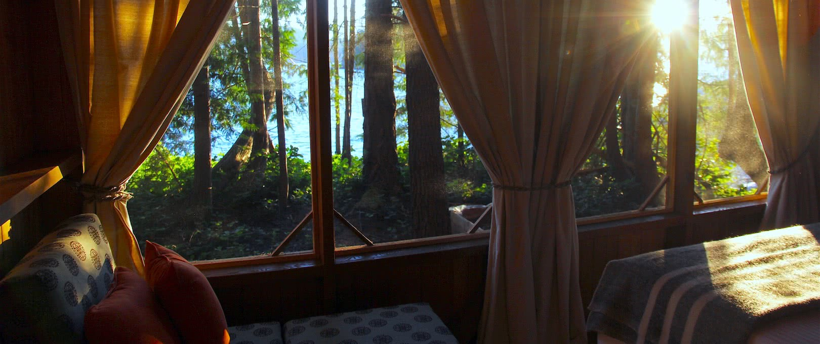 The Morning sun filtering through the trees and into one of our cabana eco resort accommodation