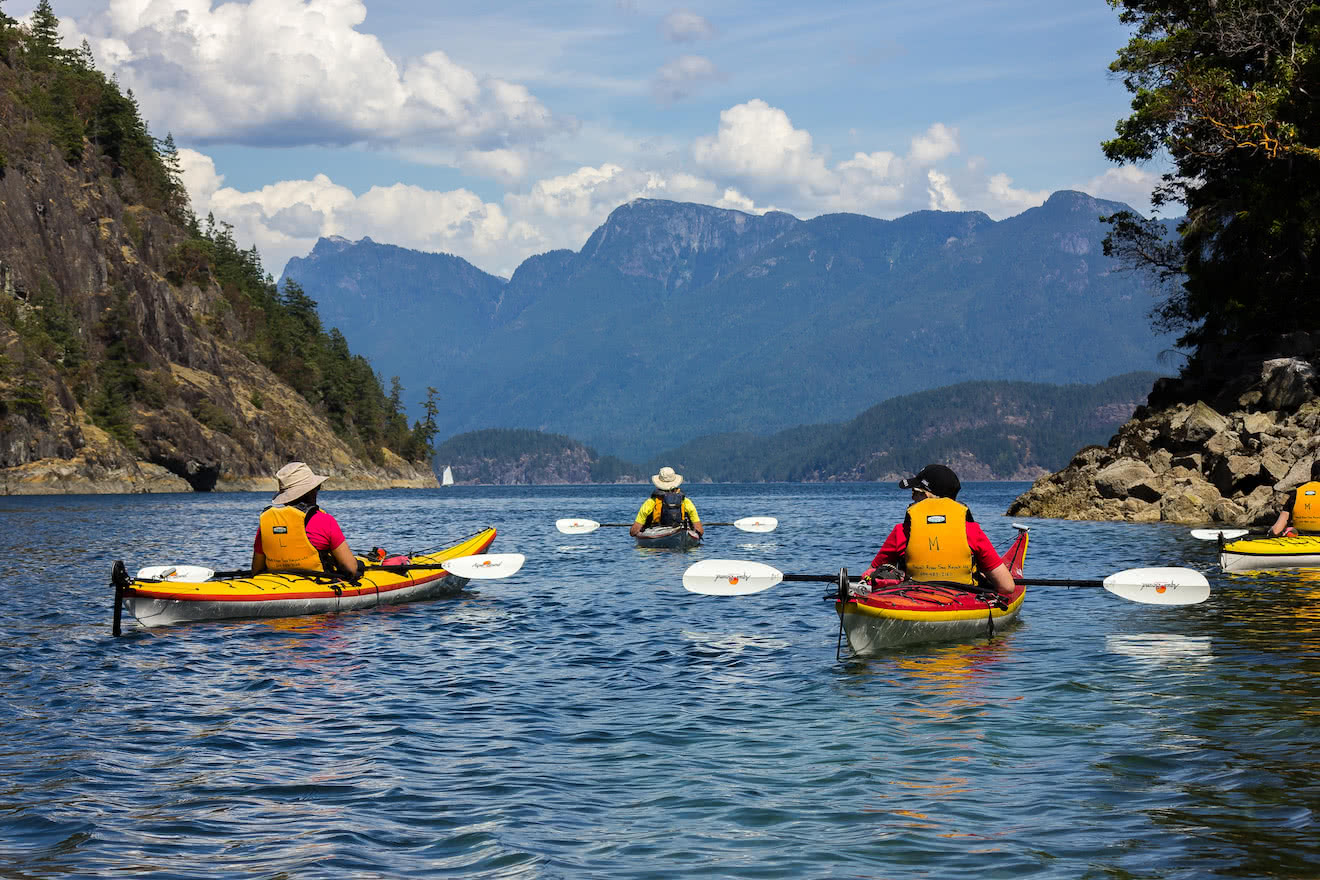 A group of less experienced kayakers on a guided kayak tour in Desolation Sound
