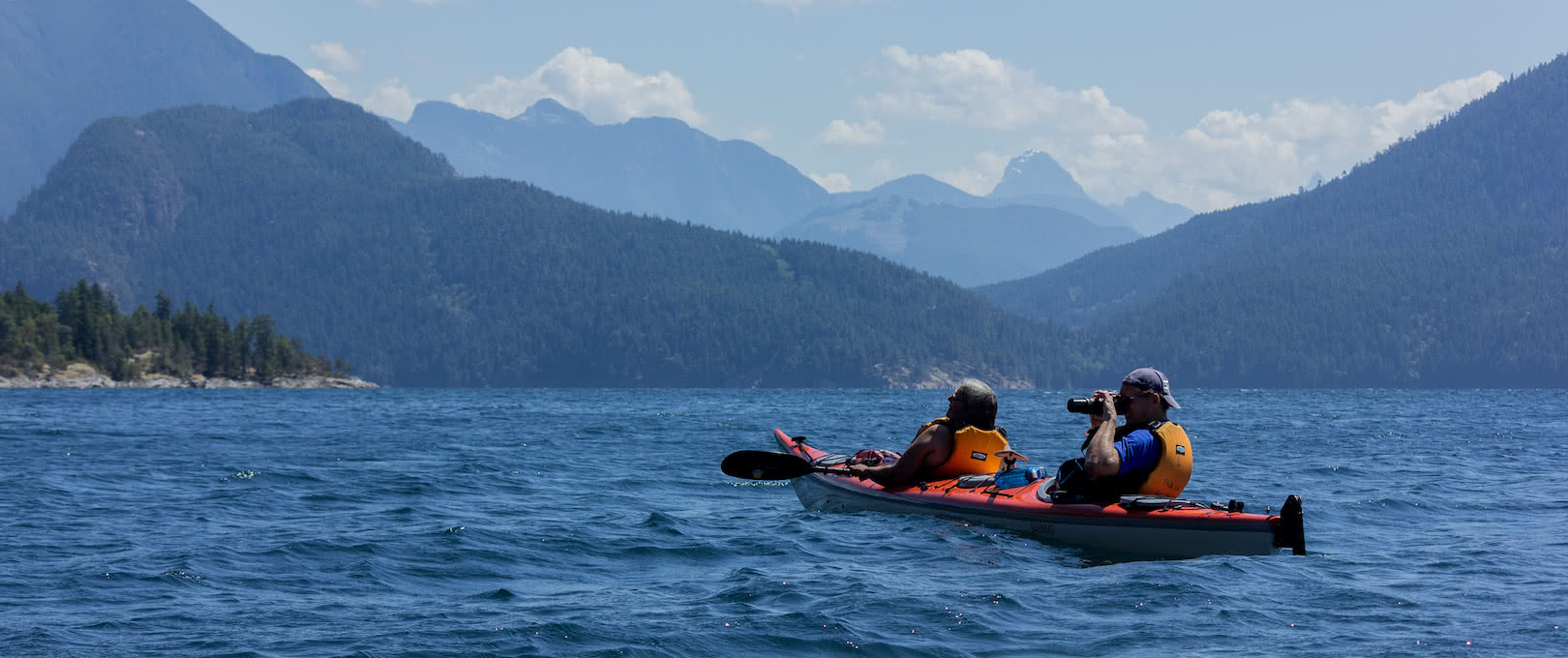 A kayaker takes a photo on a guided kayak package at the eco resort
