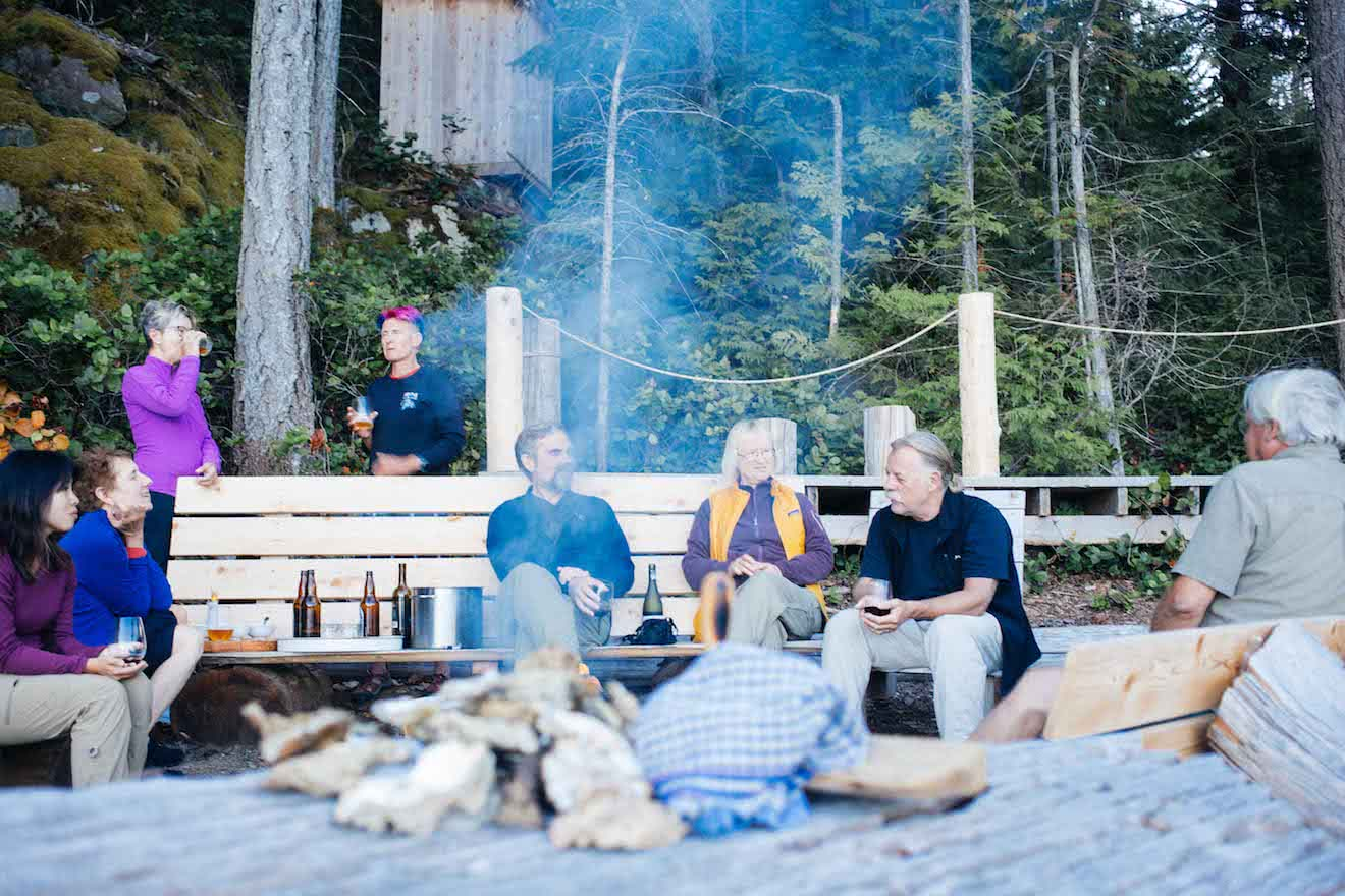 Guests relaxing by the fire in comfort in Desolation Sound