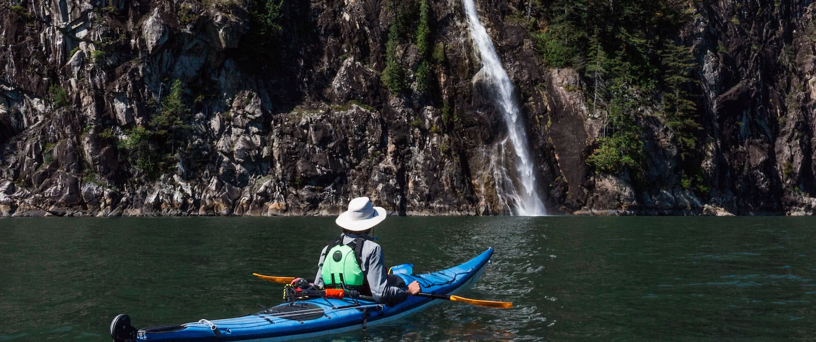 A kayaker approaches a waterfall in Toba Inlet near Desolation Sound