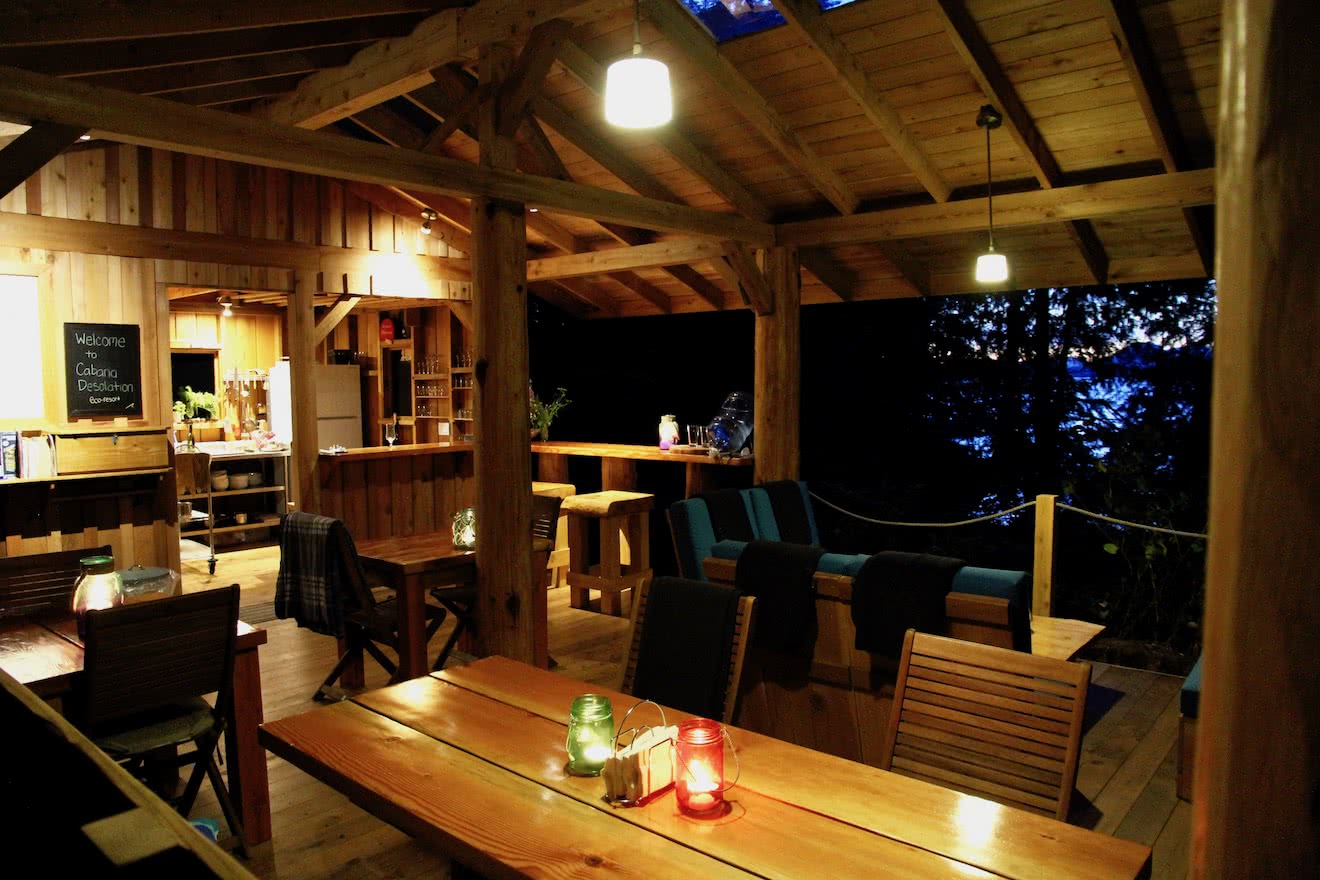 The handcrafted Cabana Cafe at night with solar powered LED lights