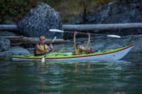 A father and son kayak in Desolation Sound on one of our guided kayaking resort packages