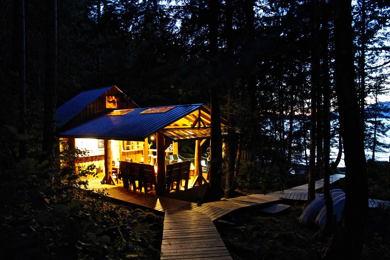 Our off-grid eco resort illuminated at night by LED lights