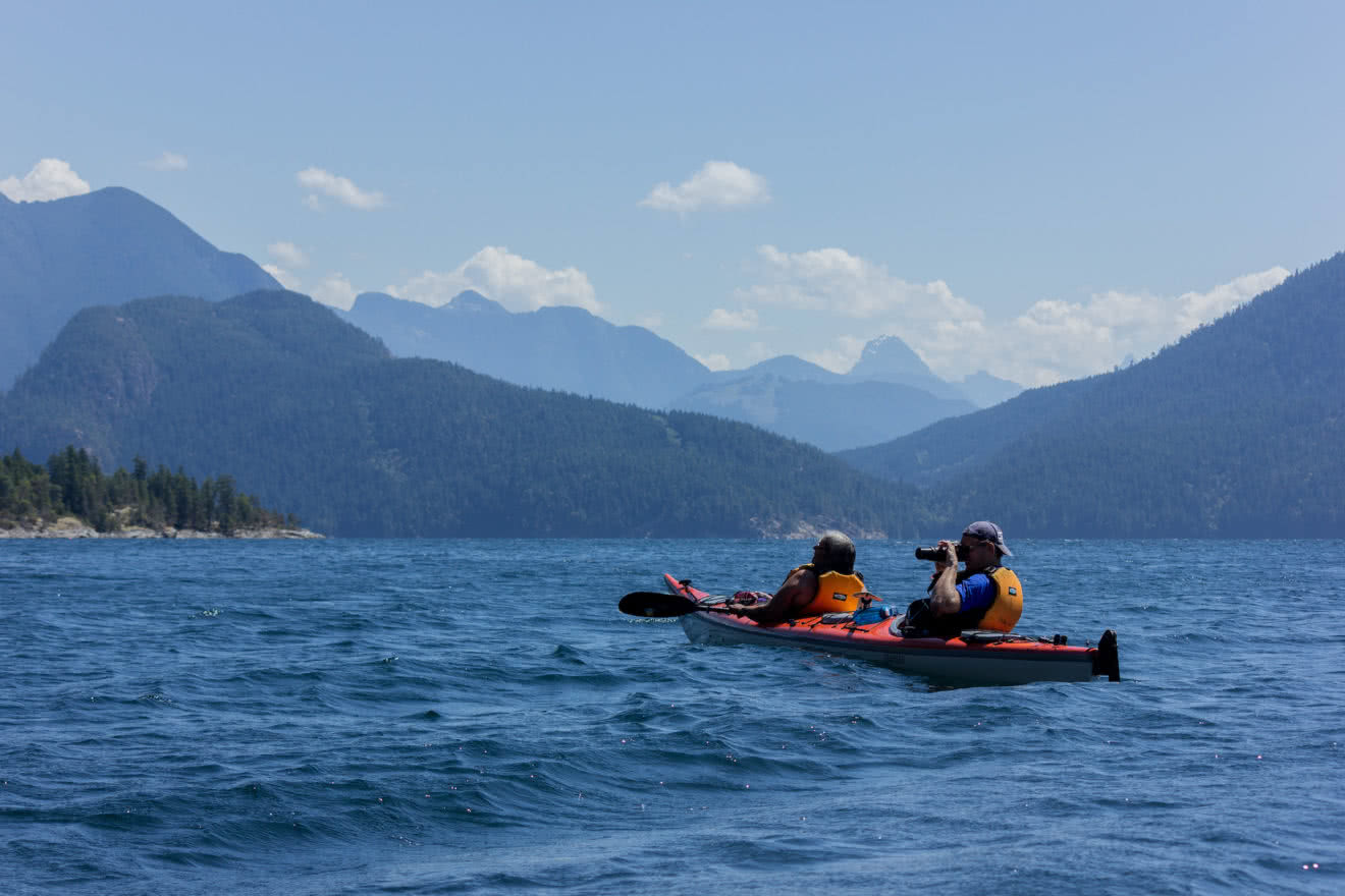 A kayaker stops to take a photo on a guided kayak package