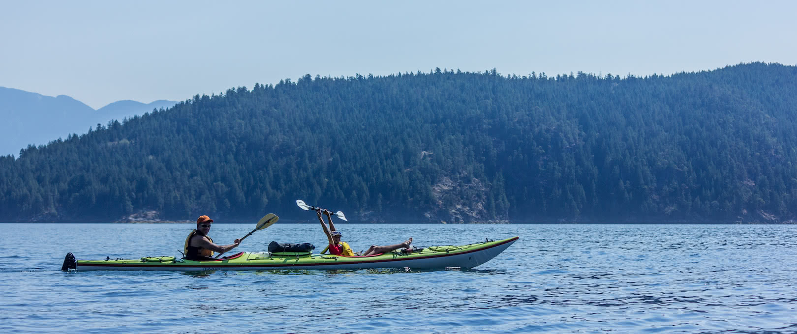 A father and son kayaking on a guided package in Desolation Sound