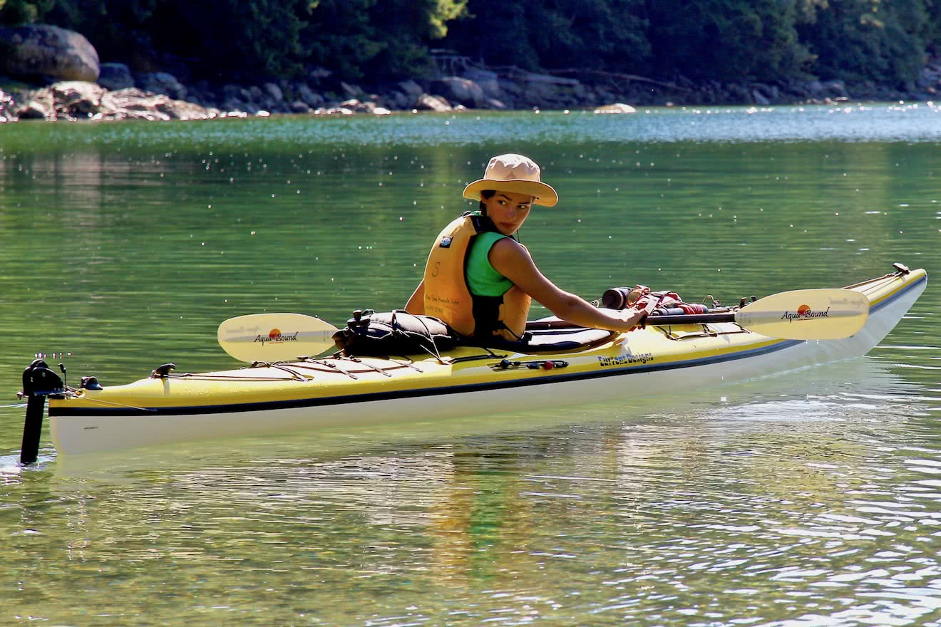 A guest travels to Cabana Desolation Eco Resort by sea kayak