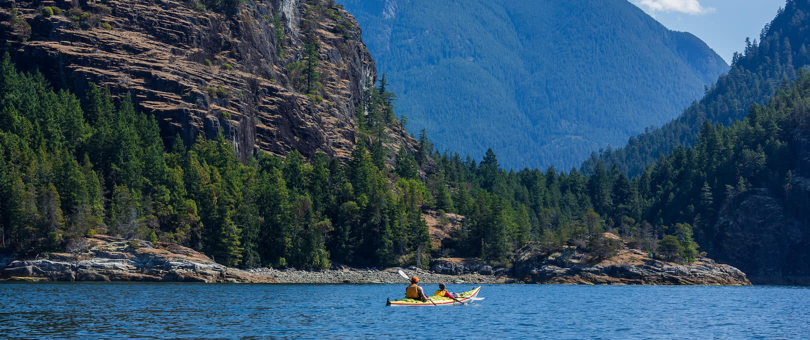 Kayakers approaching Tenedos Bay in Desolation Sound Marine Park