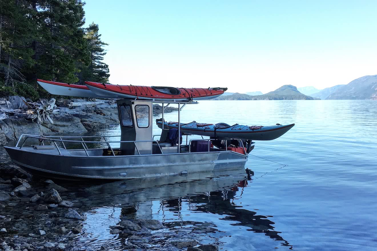 Our company motor vessel transporting kayaks to our eco resort in Desolation Sound