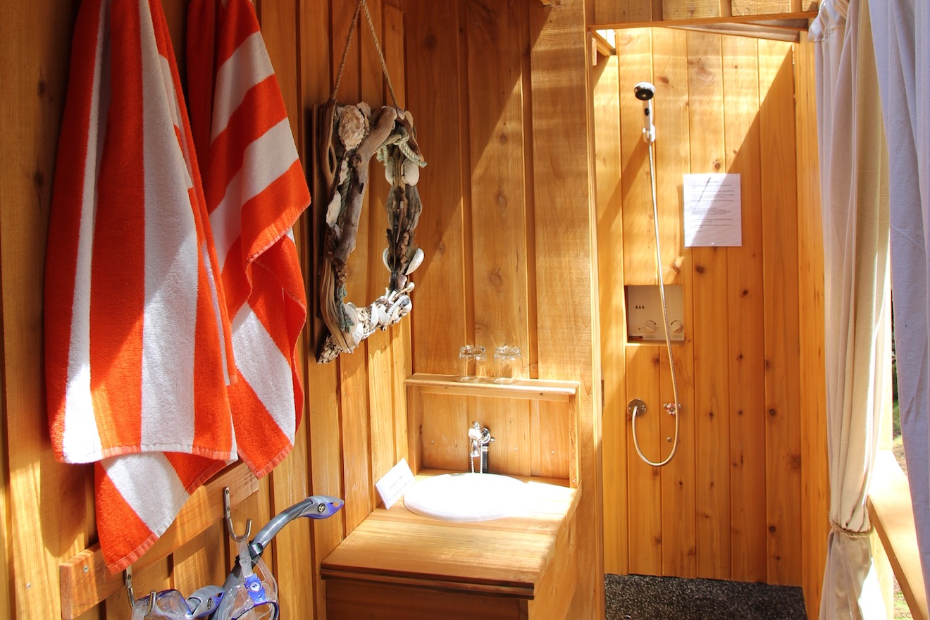 Each cabana has a personal hot water shower attached to a cabana at the resort