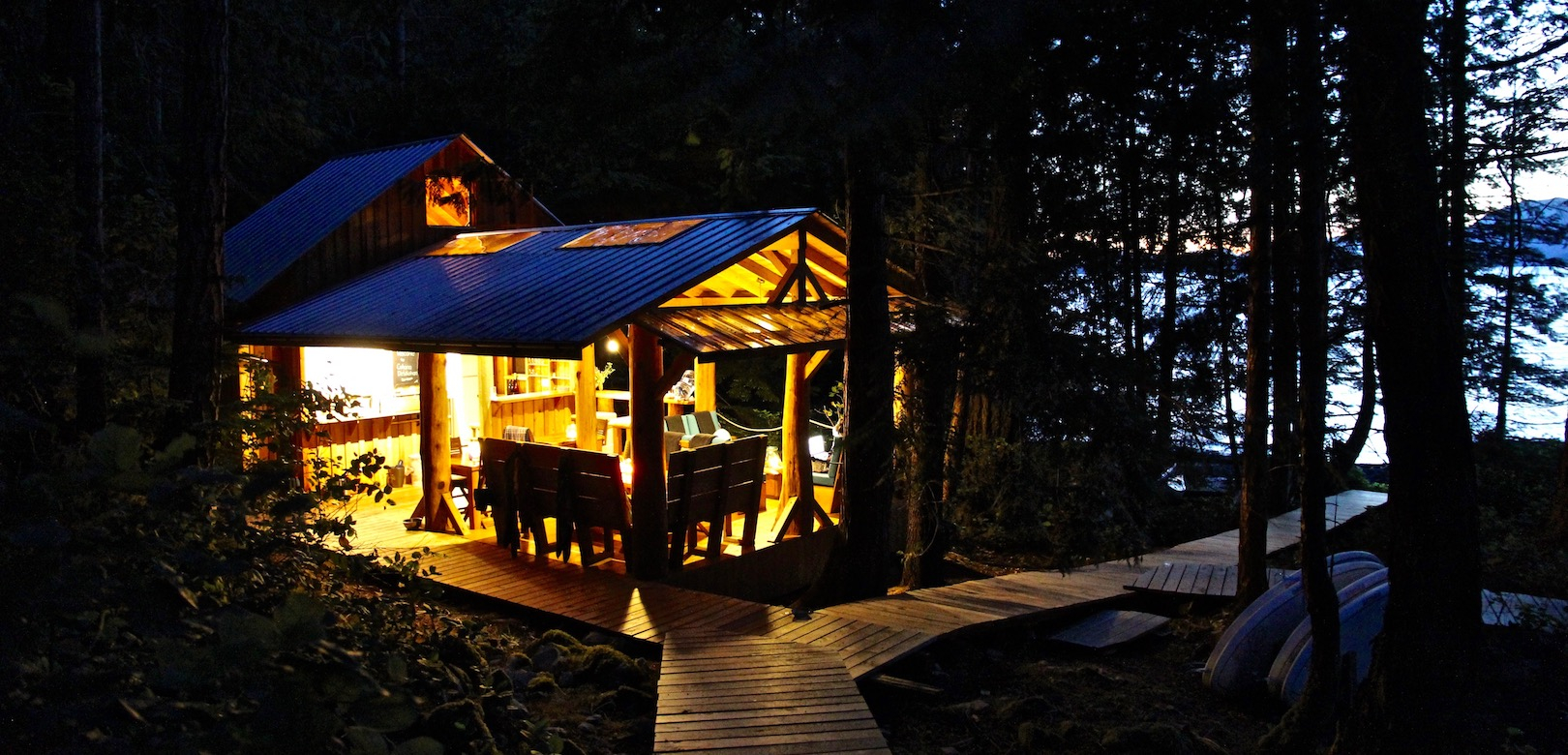 The Cabana Cafe glowing from it's LED lights on Kinghorn Island in Desolation Sound
