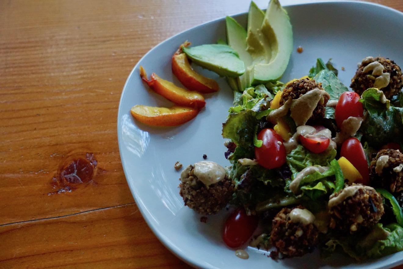 A tasty vegetarian quinoa black bean felafel salad with avocado and peach slices at Cabana Desolation Eco Resort