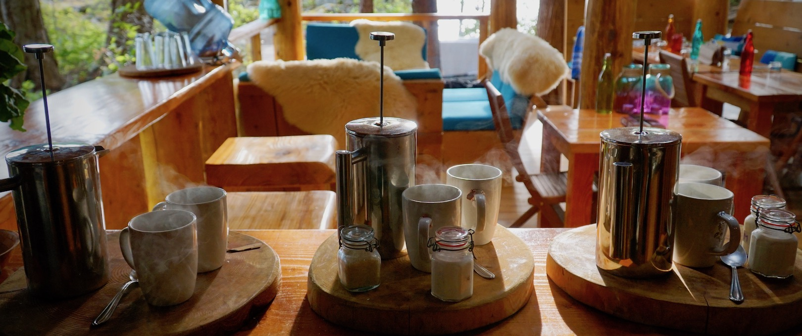 Three sets of french presses and cups of coffee at the Cabana Cafe