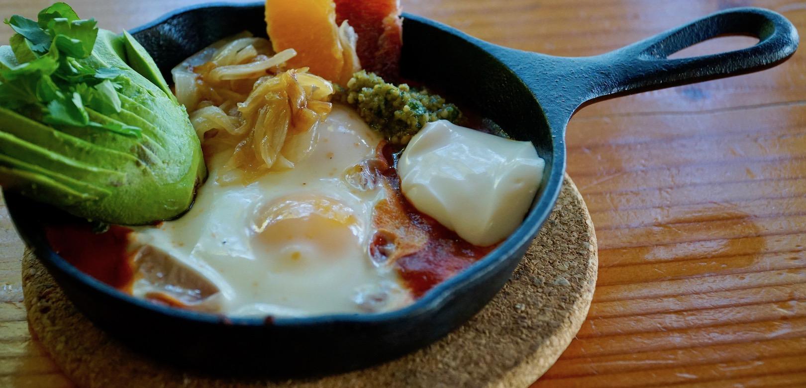 A mexican styled skillet with baked eggs and vegetables